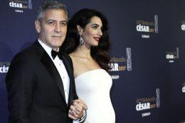 Amal Clooney Debuted her Baby Bump in Versace